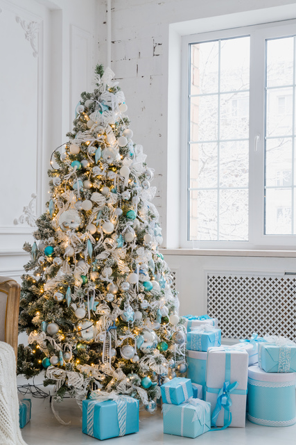 Christmas tree decoration at home interior with gift boxes